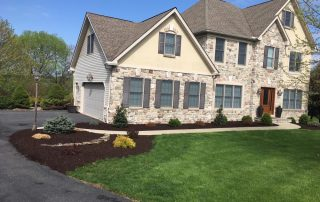 landscaping by stone house