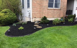 landscaping by brick house