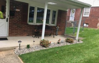 landscaping in front of brick house